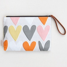Heart Print Clutch Bag by Caroline Gardner